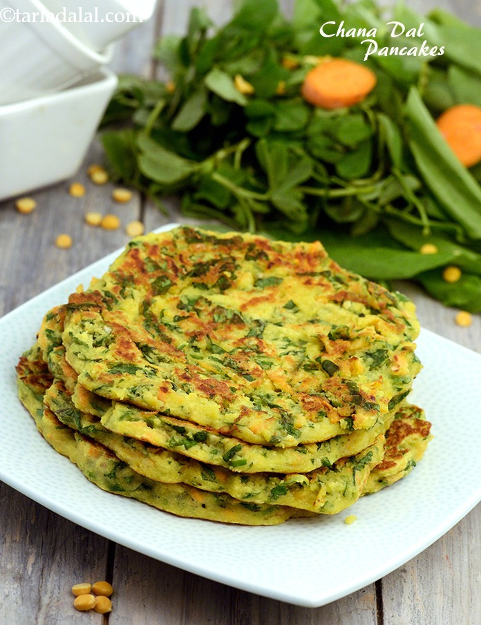 Chana Dal Pancakes, soaked chana dal mixed with vitamin rich vegetables and protein rich curds to enhance its taste. Grated ginger and green chillies add the much-needed spice to the pancakes.