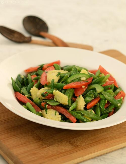 Ensalada De Ejotes (Green Bean Salad), French beans, baby corn, capsicum and tomatoes with a tangy sweet dressing served cold.