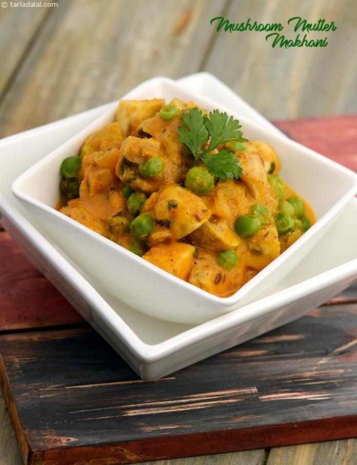 Mushroom Mutter Makhani, hearty chunks of mushrooms and green peas replace paneer in this famous Punjabi recipe.