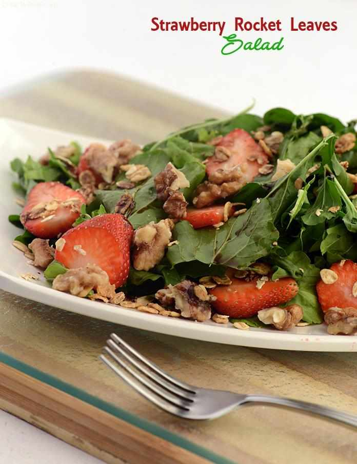 Strawberry rocket salad,a perfect hearty summer salad, bittersweet rocket (arugula)leaves combined with the sweet strawberries flavourfully tossed, topped with crunchiness is sure to be enjoyed.