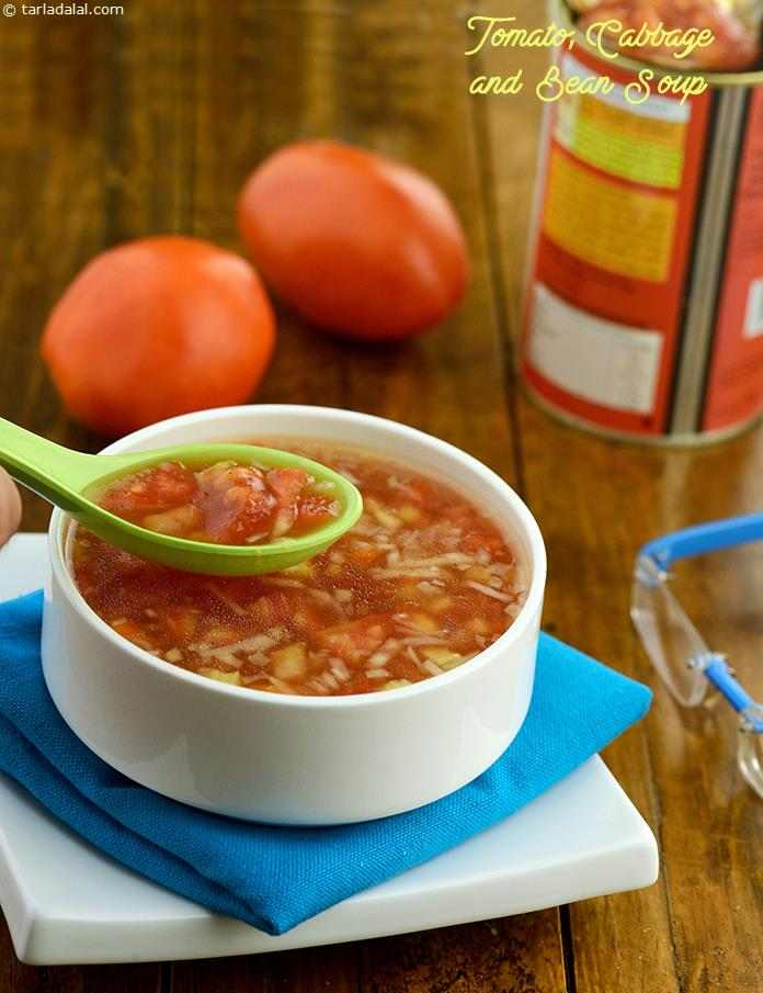 Tomato, Cabbage and Bean Soup, a lovely combination of onions, cabbage and baked beans in a potato and tomato flavoured stock makes this simple soup a delicacy!